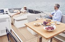 Prestige Yachts 520 Flybridge Dinette and adjacent seating sun pad