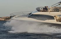 waves splashing on bow of Prestige 420