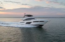 Princess Yachts F70 cruising at sunset