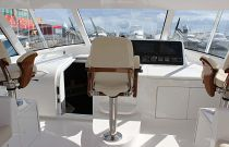 Viking Yachts 48 Sport Tower Centerline Helm Chair and Companion Seating